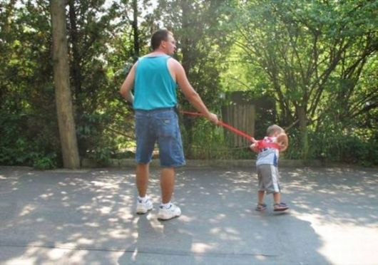 Parents Walk Their Kids On Leashes